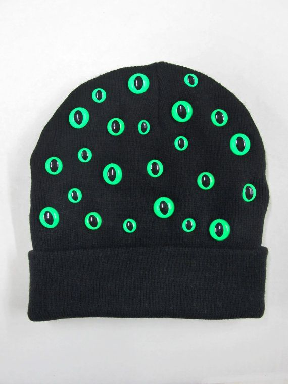 Black knit hat with neon green kitty eyes! One size fits most.    100% Acrylic