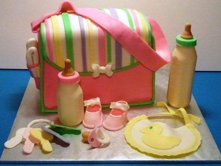 Diaper bag made out of cake, bottles are chocolate & other accessories are gumpaste. Love this, so much fun to make!  So many different directions you can take this!