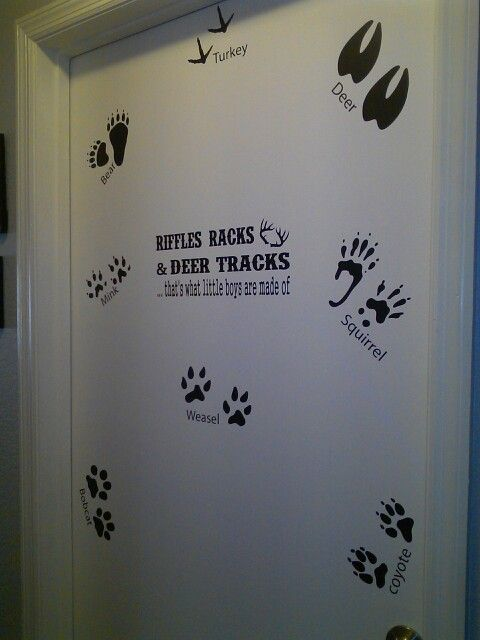 Riffles racks and deer tracks decal on door of hunting bedroom decor order your custom vinyl decals at www.facebook.com/cntrysweethearts
