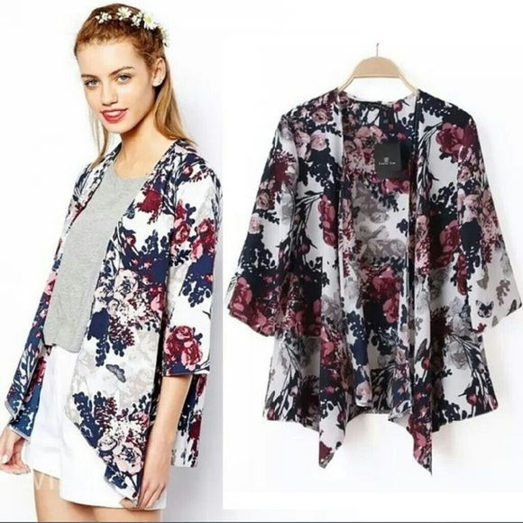 NWOT Boho floral cardigan open top Sz M Perfect for work or a summer day this top is gorgeous. Colors are really striking. New without tag. No trades no PP please dont ask! Boutique Tops Blouses