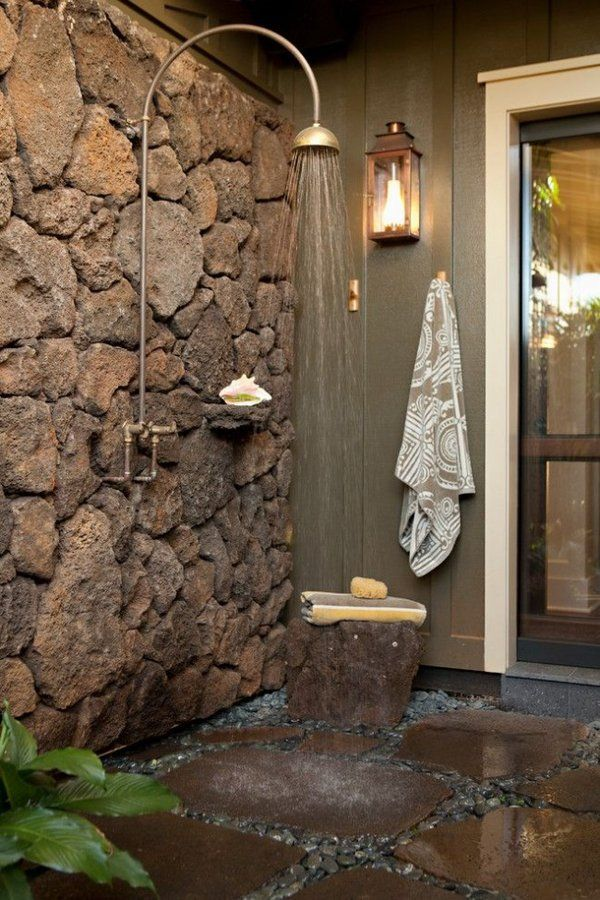 outdoor shower enclosure ideas stone wall natural stone gravel flooring