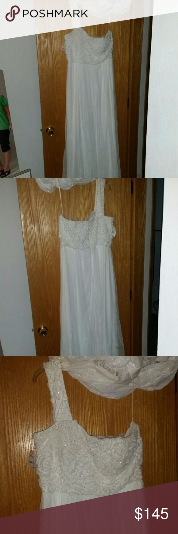 Long size 12 JS Boutique white 1 shoulder gown This gorgeous lown flowing gown from Lord & Taylor is NWT. Never used. Lightly wrinkled from being in the bag. You can easily steam it upon arrival. Perfect for a variety of occasions. Has nice sturdy elastic band to help it stay up on chest. True to size. JS Boutique Dresses One Shoulder