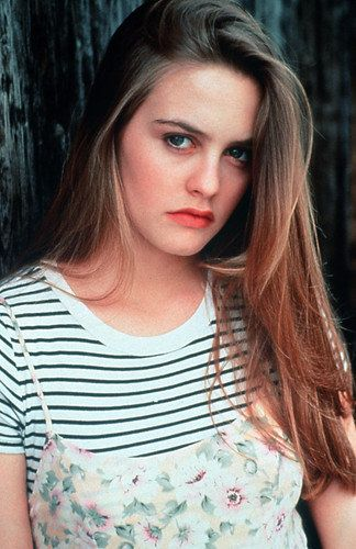 Pattern clashing, dress over a tee, Alicia Silverstone you nailed it.