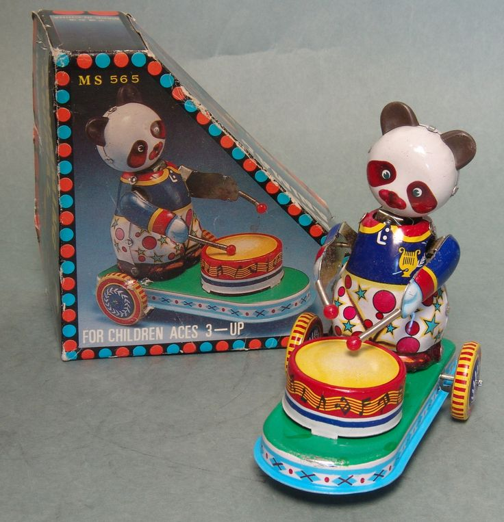 Made in China and circa the 1970's. About 5 inches tall, wind it up and it travels as the Panda's head rocks side to side and plays the drum. Great design and well made. Complete with original box and