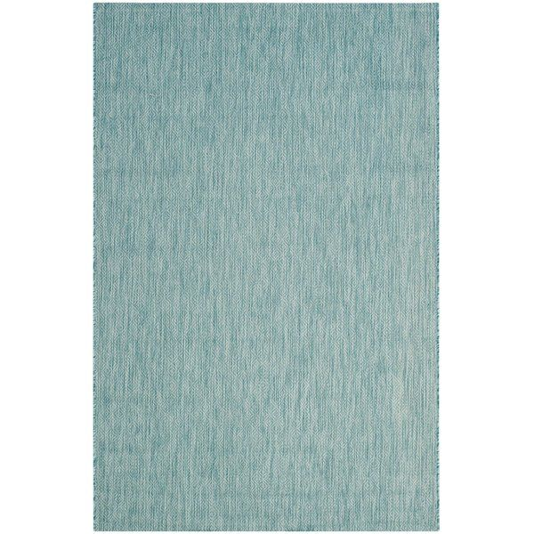 Give your floor space a splash of sea-worthy style with this lovely Adelia Aqua Area Rug. It is power-loomed of polypropylene with a low pile height for a casual design that's easy to clean. It offers up a subtle aqua hue to catch a few glances while still seamlessly blending into your decor. Perfect for high traffic areas, it makes a must-have foundation for your elegant entryway look. Lean into its traditional charm with a clean-lined wood hall tree and an antique coat rack by the front...