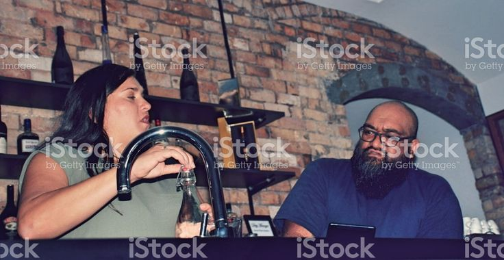 Young Maori Couple Bar Business Owners royalty-free stock photo