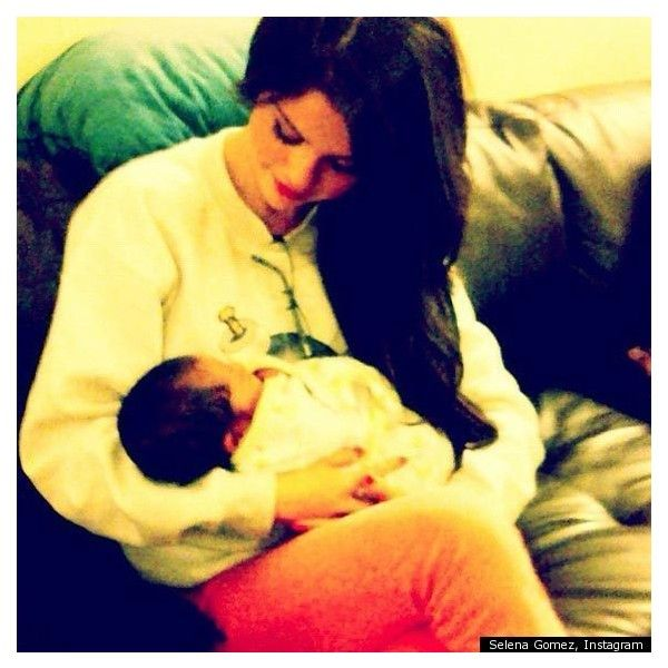 Selena Gomez Holding A Baby Singer Tweets Photo Of Newborn (PHOTO) ❤ liked on Polyvore