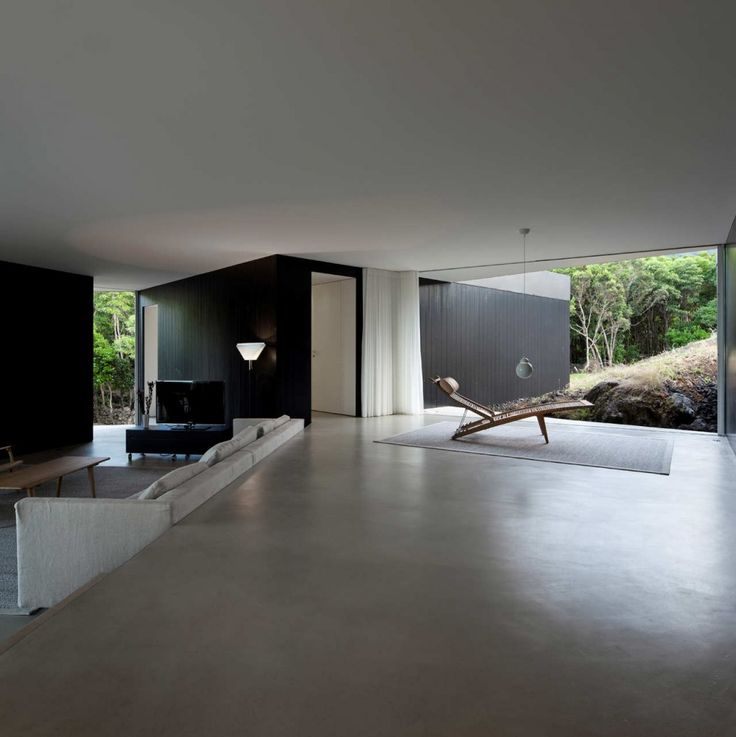 floor to ceiling windows can add to a feeling of expansiveness: House C:Z (Açores, Portugal) by SAMI-arquitectos.