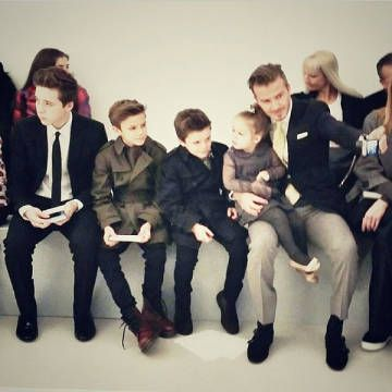 The Beckham family in all their chic glory, sitting at Victoria's fashion show. This may just be fashion week's best photo yet.