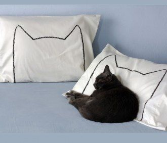 Cream cat pillow set. My dad would love this
