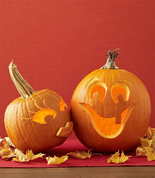 Follow the templates at WomansDay.com/GreatPumpkins to draw and carve out the lovey-dovey faces on this duo. Save some of the rind from the male pumpkin's mouth to create his partner's 3D pout. Lightly scrape in lines for eyelashes, eyebrows and lips. Materials • 2 pumpkins• Knife or pumpkin carver• Washable marker• Vegetable peeler• Damp cloth• 3 to 5 toothpicks, snapped in half Directions 1. Carve an opening out of the top of each pumpkin and scoop out the seeds. Replace the cutout. 2…