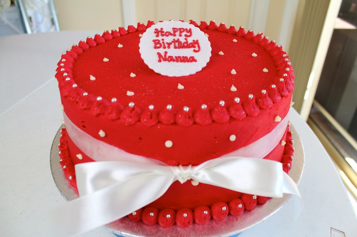 A simple birthday cake made with red butter cream icing To request a quote please email us at info@thevanillastore.com.au