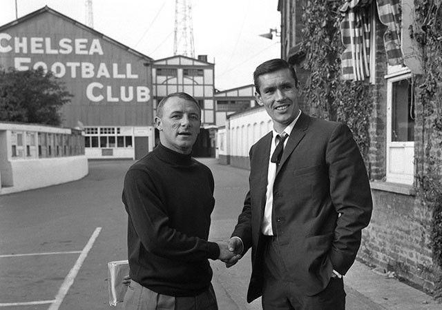 Striker TONY HATELEY (right) shakes manager TOMMY DOCHERTY's hands after signing in October 1966...