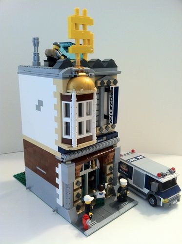 Lego Downtown Bank: A LEGO® creation by Joshua R. : MOCpages.com.  I love the big yellow $ on the roof :)