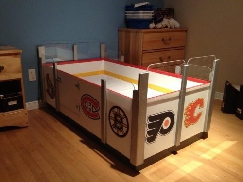 Hahhaha! A little kids hockey bed?! Would they ever sleep? Or sit up playing hockey with anything and everything that resembled a puck and stick? Hmmmm. Or, maybe they're would just have sweet hockey dreams! :)