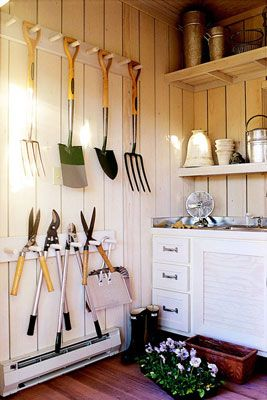 garden tools - a little too perfectly organized, and really, who has that much space in their garden shed!!! But, a good basic idea for organizing our mess of rakes, spades, etc