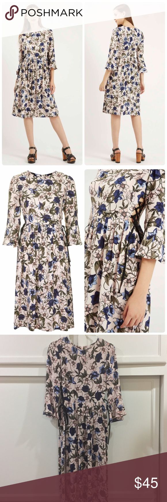 Topshop Autumn Floral Print Tie-Side Dress Floral print and lace-up details look so-now with this elegant dress. A grown-up girlie style, it sits high on the waist with tie-up sides for a peek of skin. Condition: like new. Topshop Dresses Midi