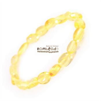 Wearing an amber bracelet might help you with general aches and pains,eczmea or arthritis.This 18cm Bambeado amber adult Lemon bean bracelet is made from large bean shaped amber pieces that have been polished so that there are no sharp edges. The amber beads bracelets are mounted on a strong elastic thread and are gorgeous on. While Bambeado amber comes in several colours, the colour is just a matter of personal choice.