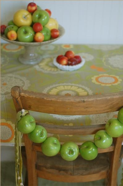 This apple chair swag comes to us from The Bride's Cafe. It would be a cute way to mark a special seat at the table for the guest of honor.