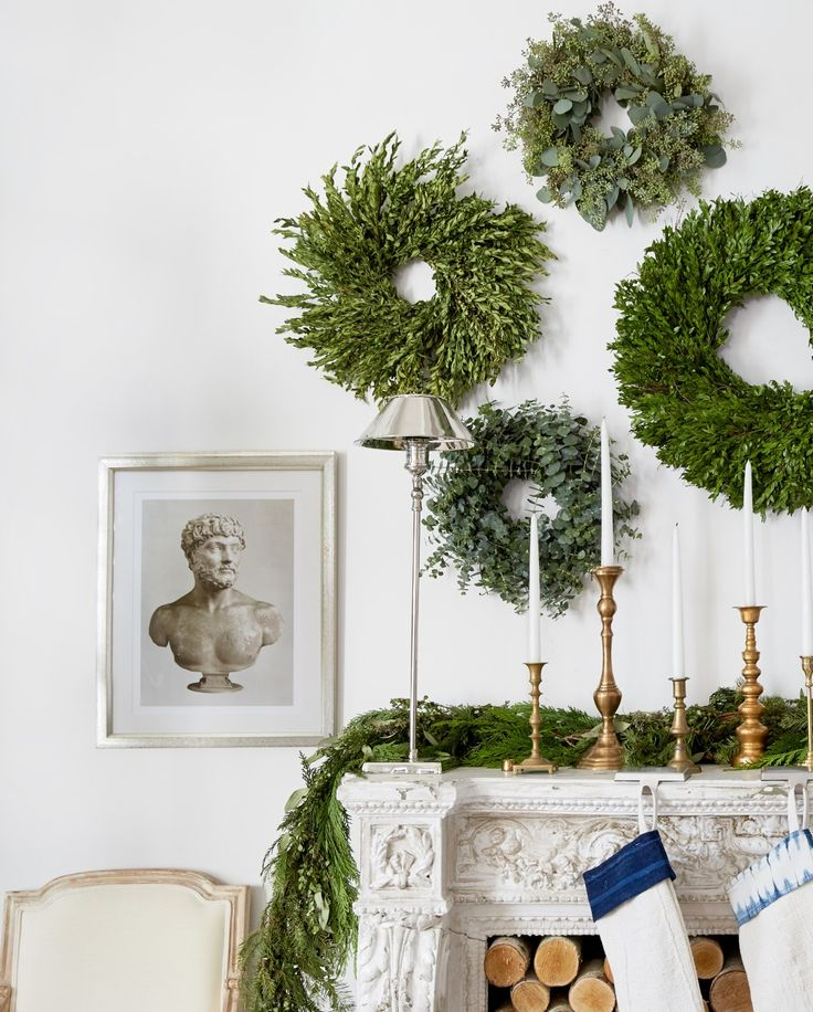 A gallery wall of wreaths serves as a perfectly festive art alternative for the holiday season.