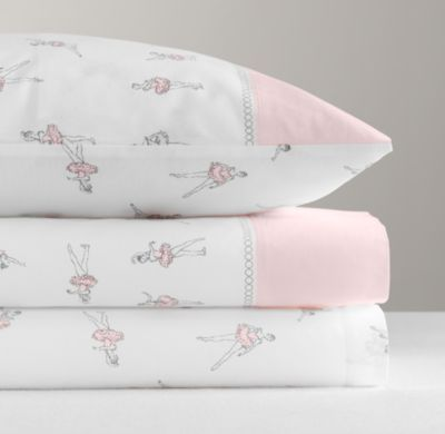 RH baby&child's Vintage Ballerina Sateen Sheet Set:Perfect for aspiring ballerinas, our soft cotton sheets feature an allover print of tutu-clad dancers in pointe shoes illustrated in a nostalgic, vintage-inspired style. Finished with a solid cuff lined with a string of printed pearls.