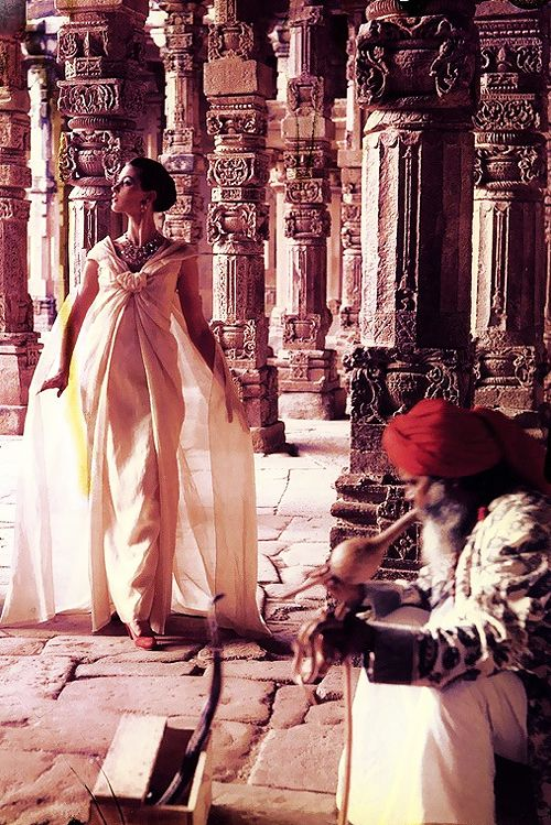 Barbara Mullen in Dior at 'The pillars of Quwat-Ul-Islam Mosque' in Dehli, India. Photo by Norman Parkinson, 1956