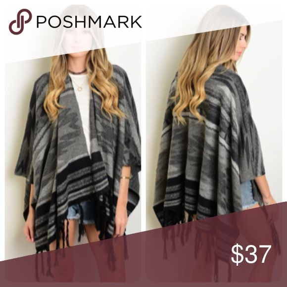 30% Off Bundles! Tribal Print Fringe Poncho Boho chic! This black and gray poncho cardigan has a tribal print and a fringe hem. Perfect for BBQs, concerts, or hanging out with your friends. Made of 60% cotton and 40% acrylic. Boutique Sweaters Shrugs & Ponchos