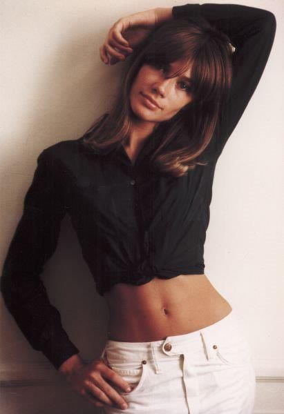 """Françoise Hardy ~ """"The French singer and actress is perhaps the best known singer of the 'ye-ye' pop music movement in France, famous particularly for the hit singles 'Tous les garçons et les filles,' 'Mon amie la rose,' and 'All Over the World' ('Dans le monde entier'). She's also famous for her girl-next-door-if-next-door-is-a-Paris-café-apartment style, equal parts innocence and mystery. Mick Jagger once described her as the 'ideal woman.' Accurate."""""""