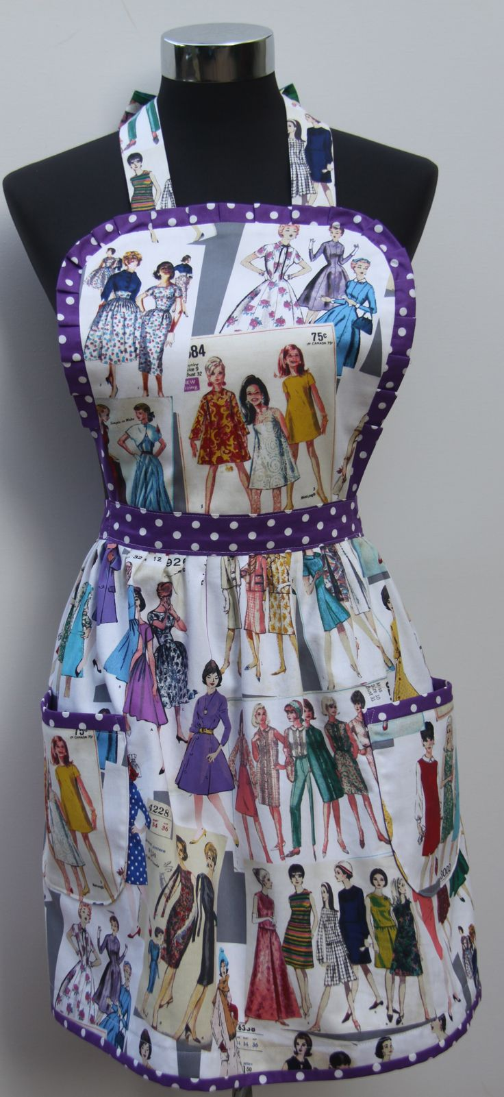 """Colour my Sixties World""   All the fashions of the 1960's in one apron. The double sided Bib has fine spot edge with pleated detail on the curves. The spotted piping continues around the waist, pockets and hemline. The pockets are fully lined in the spotted fabric. Ties around the neck and waistline.   Fabric sold out.  Style available using any fabric in the range. Handmade in Australia.   e: alollycreation@gmail.com"