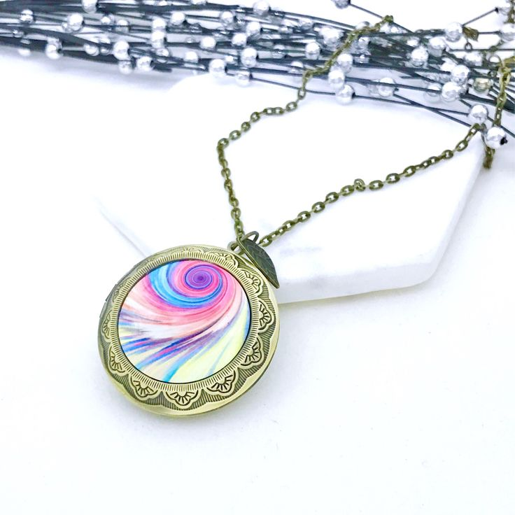 Pink Yellow Swirl photo Locket. Antique Bronze by VividSister on Etsy https://www.etsy.com/au/listing/535046529/pink-yellow-swirl-photo-locket-antique