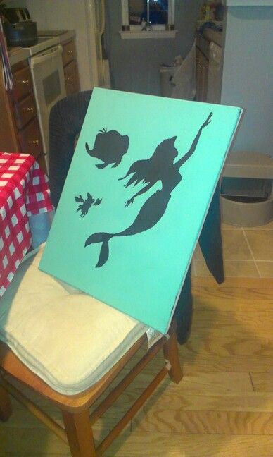 The little mermaid silhouette. Could do this DIY....just print and cut out the silhouettes then paint whole canvas over them.