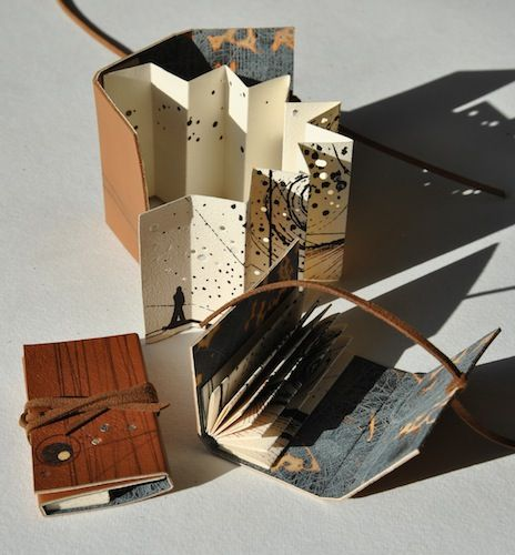 Louisa Boyd - Stardust, 2013. Three editions of a screen printed concertina artist's book with etched end papers, depicting a figure within a landscape. L...