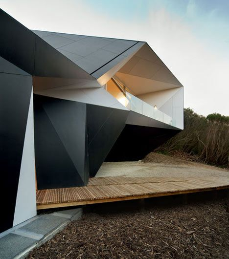 The walls of this house in Australia by architects McBride Charles Ryan have origami-like facets and folds.