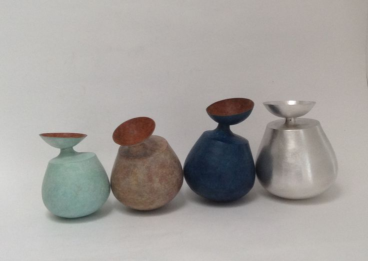 Wah Wah! 3 copper patinated forms and one in silver