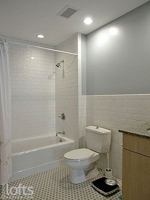 White Subway Tile Wraps The Wall Behind Toilet And Vanity
