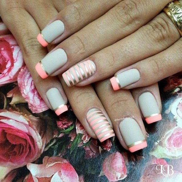 Add more attitude to your white and melon themed French tip with silver metallic strips on top.