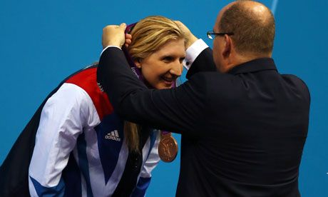 Rebecca Adlington is presented with her bronze medal from the 400m freestyle, Team GB's first Olympic medal in the pool.