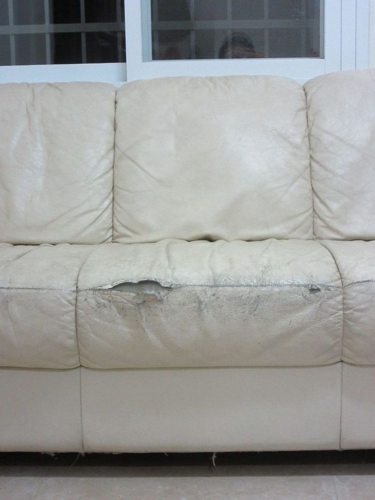 Instead of using a slip cover, here's how she hides the rips on her couch