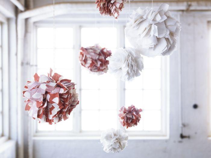 Shredded fabric pom-poms - handmade, lighthearted, and whimsical.