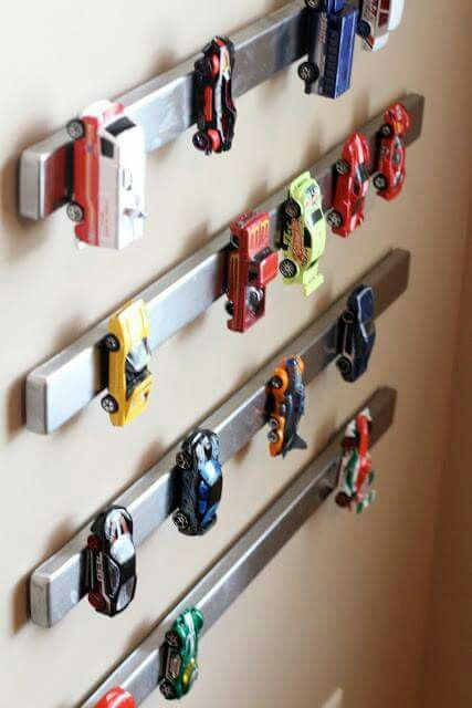 Magnetic knife strip for car storage. This would be so perfect for his 'hand cars'!! Of course in our lives, we'd have to have probably 20 or more. It would be so interesting to see how he'd organize them...