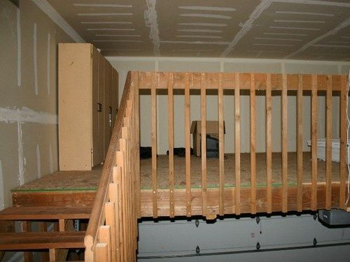 Loft storage with stairs in garage.  Great for my garage and easy to get to so husband doesn't have to get decorations