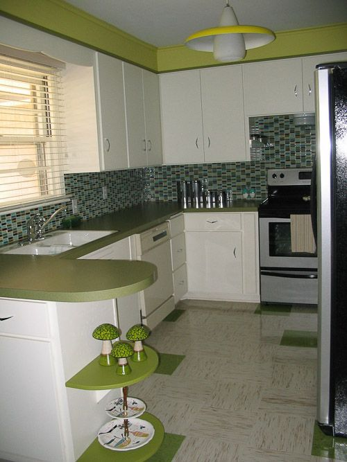 great kitchen  I love the green.  wall tile a bit out of place.  Azrock flooring  - i like the green mixed in