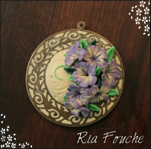 Handcrafted polymer clay pendant with lilac & cream mini flowers