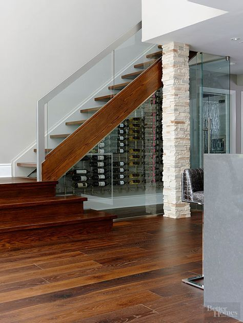 Wine Closet Below The Stairs - Complete With A Glass Railing