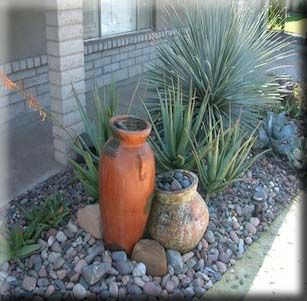 Nice Pots Filled With Rocks   Good Idea!