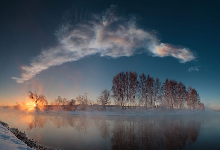 Explanation: Each day on planet Earth can have a serene beginning at sunrise as the sky gently grows bright over a golden eastern horizon. This sunrise panorama seems to show such a moment on the winter morning of February 15. In the mist, a calm, mirror-like stretch of the Miass River flows through the foreground along a frosty landscape near Chelyabinsk, Russia. But the long cloud wafting through the blue sky above is the evolving persistent train of the Chelyabinsk Meteor.