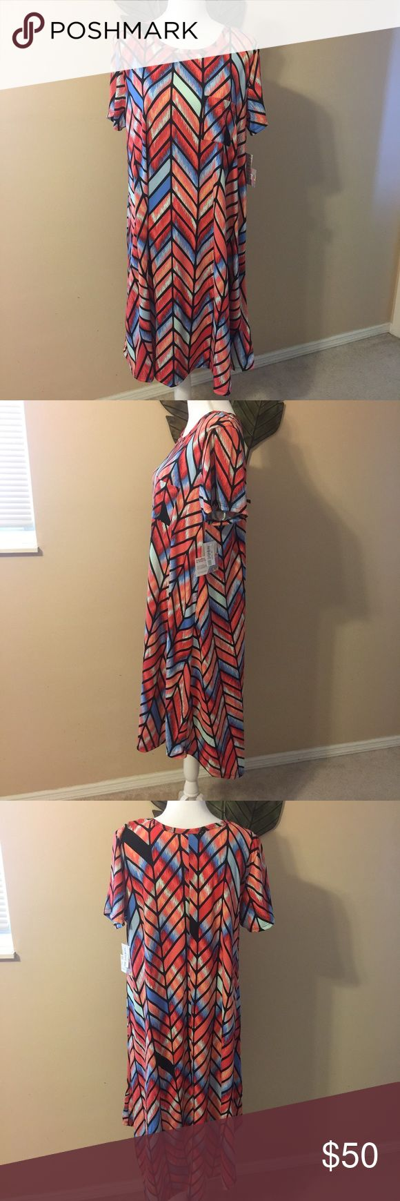 Lularoe Carly Dress NWT! Amazing colors!  Carly high-low style dress. Last pic shows how versatile the dress is! Made in Mexico. 96% polyester and 4% spandex. Please be familiar with LLR sizing before purchasing. This dress runs approx 1-2 sizes bigger than a normal XL.  My price is already discounted to help with shipping costs 🙂. LuLaRoe Dresses High Low