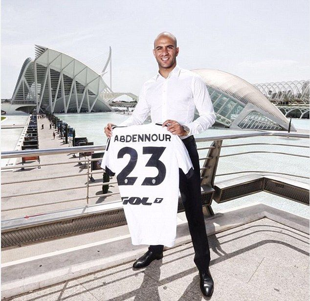 Aymen Abdennour poses with a Valencia shirt after signing for the La Liga club on Saturday night - £22m - 2015