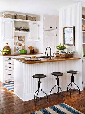 White kitchen, butcher block, wood floors, barstools