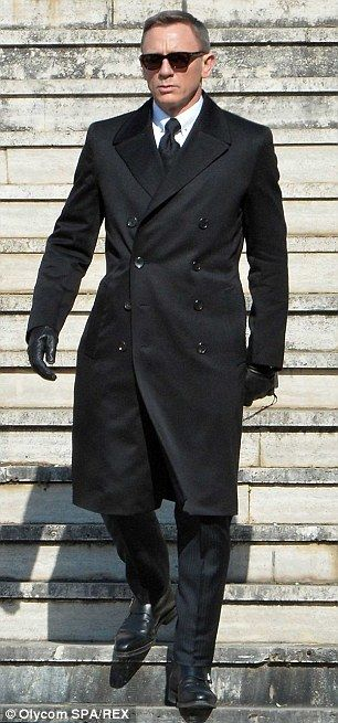 Back to black: Daniel Craig and Monica Bellucci were spotted shooting a funeral scene in Rome on Thursday